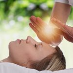 persons healing using Reiki Transformations logo Marina Collins Hypnotherapy Anxiety specialist